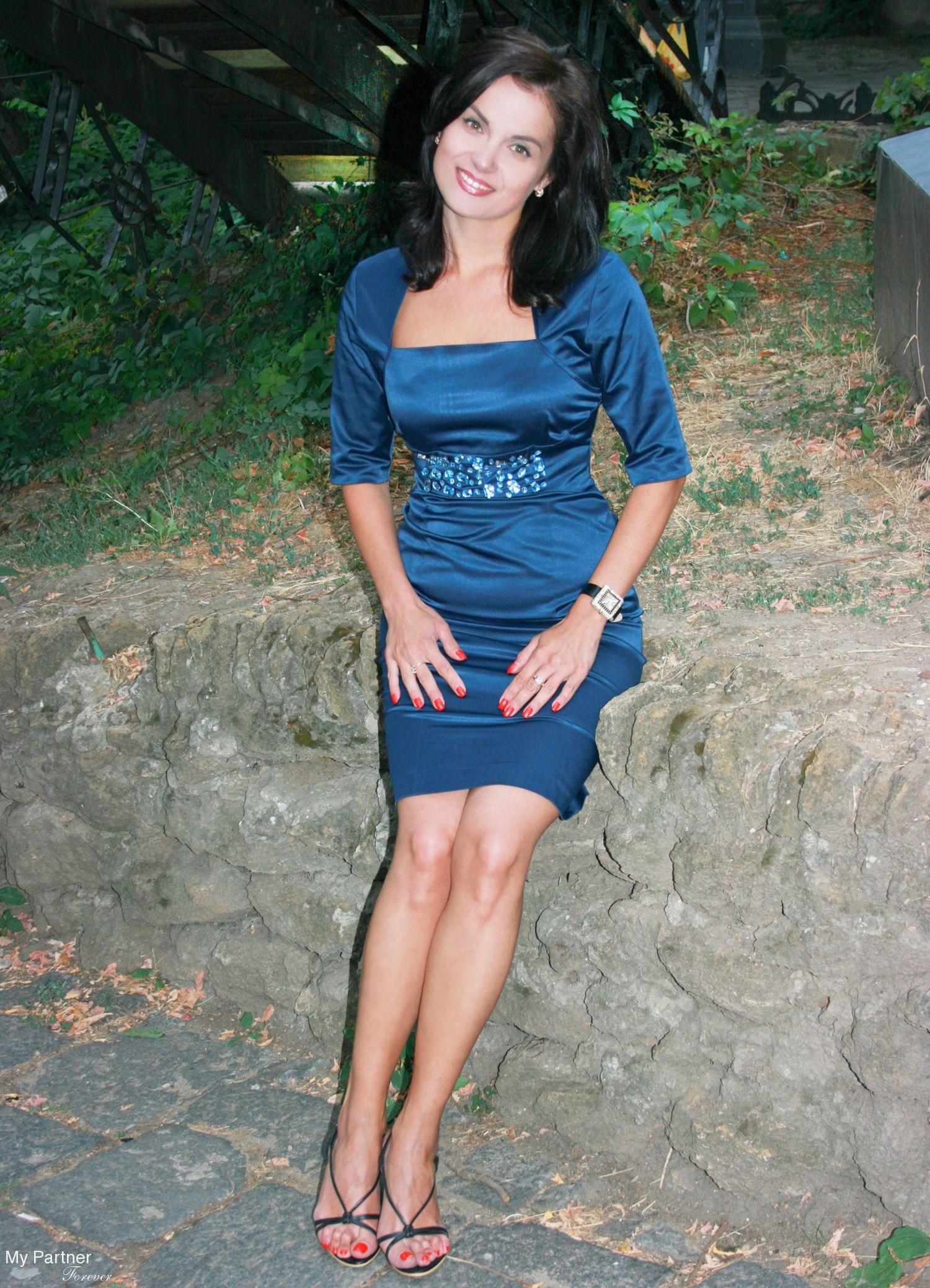Beautiful tan brunette with dildo